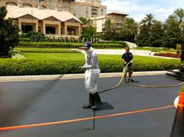 Man Asphalt spray Sealcoating