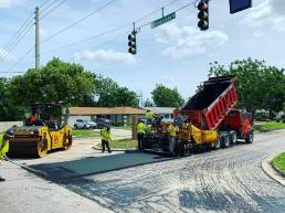 Asphalt crew paving intersection
