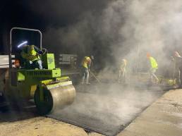 Asphalt crew night paving steam fog