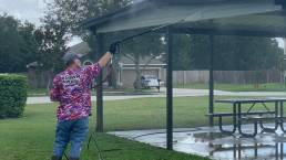 Crew pressure washing picnic pavilion