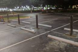 Bollard install parking lot at night